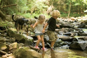 Kids in creek with dog - Childhood Memories Photo Contest Honorable Mention
