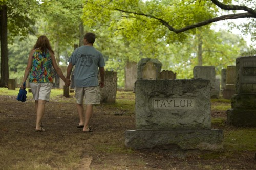 Taylor family members walk throught the cemetery